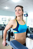 Athletic girl engaged in the gym Royalty Free Stock Photos