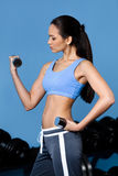 Athletic girl exercises with dumbbells Stock Photos