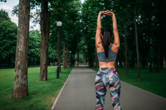 Athletic girl on fitness training in summer park Royalty Free Stock Photo