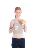 Athletic girl with a glass of juice and a thumbs up Royalty Free Stock Image