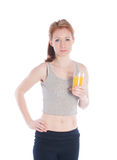 Athletic girl with a glass of juice Royalty Free Stock Photography