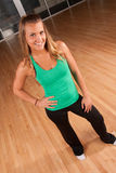 Athletic girl in a gym. A pretty, athletic girl poses in the gym Royalty Free Stock Image