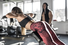 Athletic girl in gym Royalty Free Stock Photo