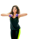 Athletic girl holding a dumbbell Royalty Free Stock Images