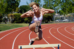 Athletic girl hurdling Royalty Free Stock Images