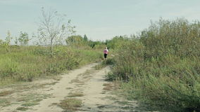 Athletic girl jogging in the country stock video