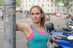 Athletic Girl Leaning Against the Street Post Royalty Free Stock Photo