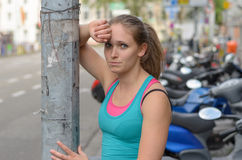 Athletic Girl Leaning Against the Street Post Stock Photos