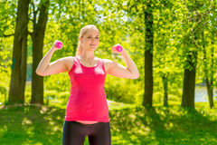 Athletic girl maintains shape during pregnancy stock photo