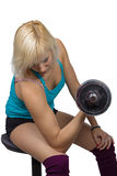 Athletic girl making exercises with dumbbell Stock Image