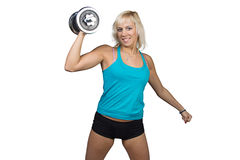 Athletic girl making exercises with dumbbell Royalty Free Stock Images