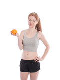 Athletic girl with orange in hands Stock Photo