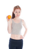 Athletic girl with orange in hands Royalty Free Stock Images
