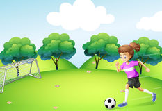 An athletic girl playing soccer Royalty Free Stock Images