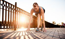Athletic girl preparing to run Royalty Free Stock Photography