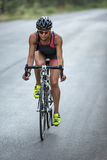 Athletic girl rides a bike Stock Photography