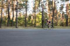 Athletic girl rides a bike Royalty Free Stock Photography
