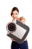 Athletic girl with a scale Stock Image