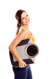 Athletic girl with a scale Stock Photography