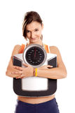 Athletic girl with a scale Stock Photos