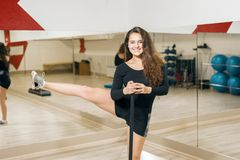 Athletic girl doing leg swing. woman trains stretching royalty free stock images