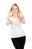 Athletic girl shows two thumbs Stock Photography