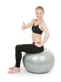 Athletic girl with a silver ball Royalty Free Stock Images