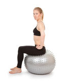 Athletic girl with a silver ball stock image