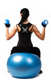 Athletic girl sitting on fitness ball Royalty Free Stock Image
