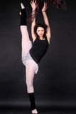 Athletic girl stretching her leg Royalty Free Stock Photo