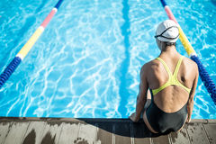Athletic girl in the swim pool Royalty Free Stock Photos
