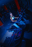 Athletic girl on treadmill at gym Stock Photo