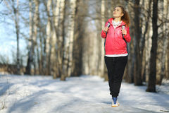 Athletic girl on a walk in the park. Young athletic girl on a walk in the park Royalty Free Stock Image