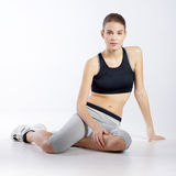 Athletic girl on a white background Royalty Free Stock Photo