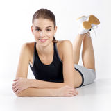 Athletic girl on a white background Royalty Free Stock Image
