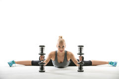 Athletic Girl With Dumbbells Royalty Free Stock Photography