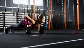 Athletic girl works out at the gym with a kettlebell Stock Photo