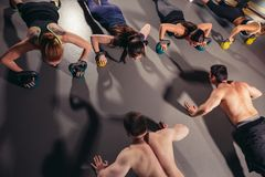 Athletic group of people exercising Royalty Free Stock Image