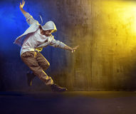 Athletic guy dancing a hip hop. Athletic b-boy dancing a hip hop stock photos