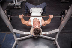 Athletic Guy In The Gym Exercising Royalty Free Stock Photo
