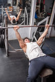 Athletic Guy In The Gym Exercising Stock Images