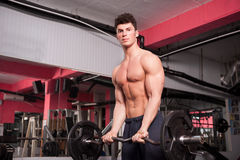 Athletic guy in the gym Royalty Free Stock Photo