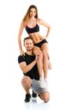 Athletic guy holds on shoulder a girl on a white Stock Images