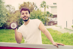 Athletic guy laughing warm tones filter applied Stock Photos