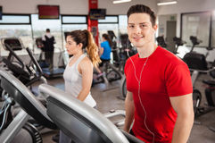 Athletic guy listening to music and doing cardio Royalty Free Stock Images