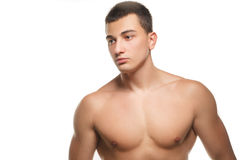 Athletic guy shows his muscles Stock Photography