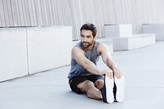 Athletic guy stretching Royalty Free Stock Image