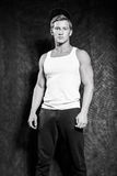Athletic guy in a vest and  baseball cap Royalty Free Stock Photos
