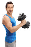 Athletic guy working out with a dumbbell Stock Photo