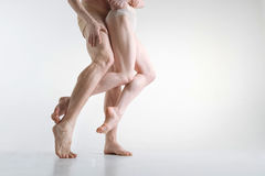 Athletic gymnasts legs demonstrating grace in the studio royalty free stock photo